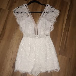 Stunning white lace cut out romper